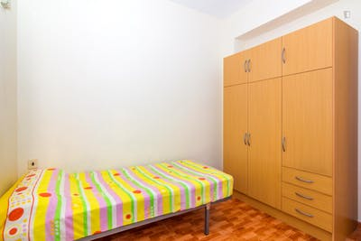 Humble single bedroom with a sunny balcony, in Campoamor
