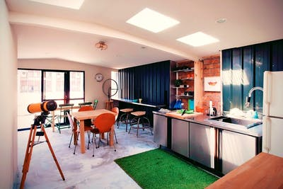 Renovated Spacious Modern Apt. w/ Workspace + Rooftop Deck