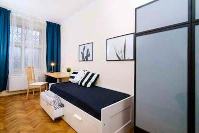 Tasteful twin bedroom in the Holešovice district