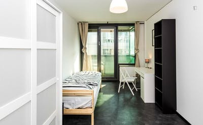 Bright bedroom with balcony in a 2-bedroom apartment